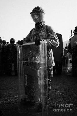 Terrorist Photograph - British Army Soldier In Riot Gear Stands Guard On Crumlin Road At Ardoyne Shops Belfast 12th July by Joe Fox