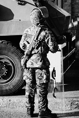 British Army Soldier In Riot Gear With Sa80 In Front Of Saxon Vehicle On Crumlin Road At Ardoyne Sho Art Print by Joe Fox