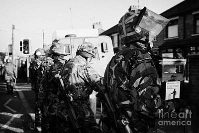 British Army Soldiers In Riot Gear Stand Guard On Crumlin Road At Ardoyne Shops Belfast 12th July Art Print by Joe Fox