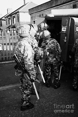 Terrorist Photograph - British Army Soldiers Pack Up Riot Gear On Crumlin Road At Ardoyne Shops Belfast 12th July by Joe Fox