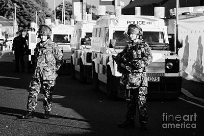 Terrorist Photograph - British Army Soldiers With Psni Landrovers On Crumlin Road At Ardoyne Shops Belfast 12th July by Joe Fox