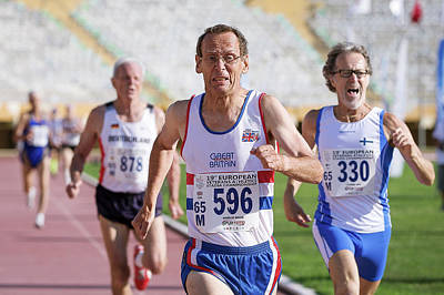 60s Photograph - British Masters Athlete Leads The Race by Alex Rotas