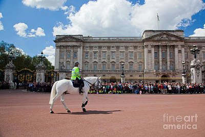 Unity Photograph - British Royal Guards Riding On Horse And Perform The Changing Of The Guard In Buckingham Palace by Michal Bednarek