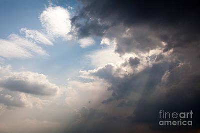 Broken Rain Clouds With Blue Sky And Sun Streaming Through Cloud Art Print