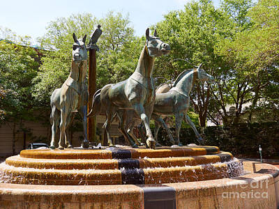 Bronze Horse Photograph - Bronze Sculpture Of Four Horses In Front Of Charleston Place by Louise Heusinkveld