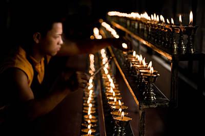 Oil Lamp Photograph - Buddhist Monk Lighting Lamps by Nila Newsom