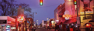Evening Scenes Photograph - Buildings Along The Street Lit by Panoramic Images