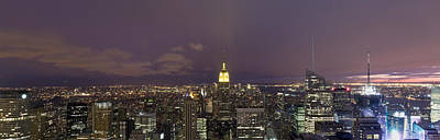 Buildings In A City Lit Up At Dusk Art Print by Panoramic Images