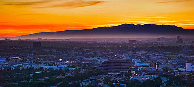 Sunset Studios Photograph - Buildings In A City With Mountain Range by Panoramic Images