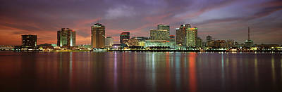 Orleans Photograph - Buildings Lit Up At The Waterfront, New by Panoramic Images