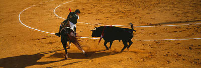 Bullfighter Photograph - Bullfighter Taunting Bull In Ring by Panoramic Images
