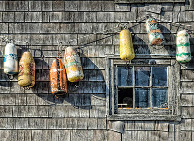 Photograph - Buoys On A Wall At Peggys Cove by Rob Huntley
