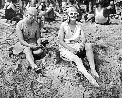 Buried Photograph - Buried At The Beach by Underwood Archives