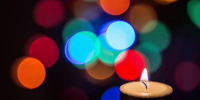 Diwali Photograph - Burning Candle With Colorful Bokeh by Vishwanath Bhat