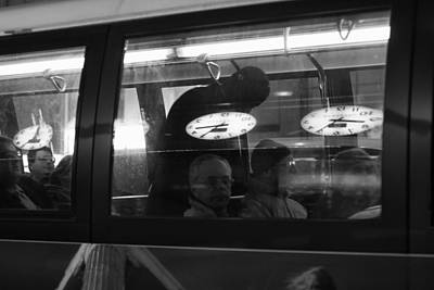 Photograph - Bus With Clocks by Dave Beckerman
