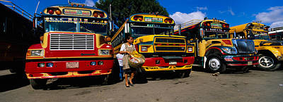 Bus Photograph - Buses Parked In A Row At A Bus Station by Panoramic Images