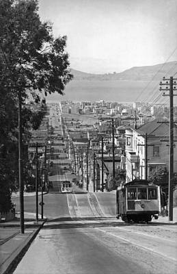 Horizon Lines Photograph - Cable Cars On Fillmore Street by Underwood Archives