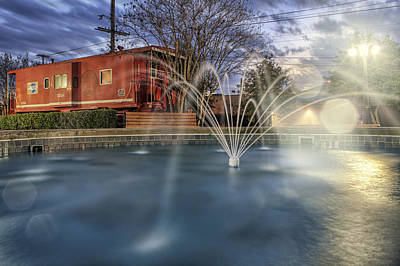 Photograph - Caboose And Fountain At Dusk by Jason Politte
