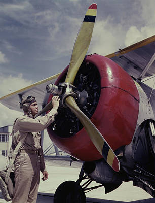 One-man Plane Photograph - Cadet Checking The Propeller On A Plane by Stocktrek Images