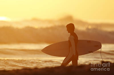 California, San Clemente, Surfer Walking Towards Ocean At Sunset. Editorial Use Only. Art Print by MakenaStockMedia