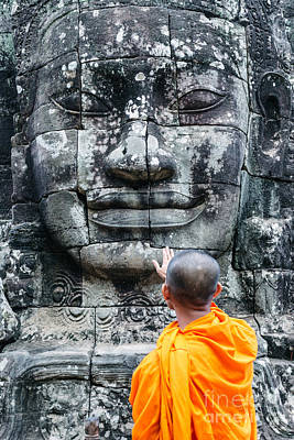 Hands Images Photograph - Cambodia - Angkor Wat - Monk Touching Giant Buddha Statue by Matteo Colombo