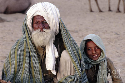 Photograph - Camel Trader With Grandson - Pushkar Camel Fair by Craig Lovell