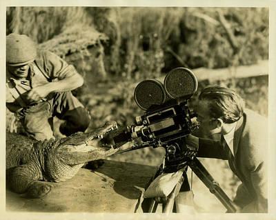 Cameraman With Alligator Art Print by Vintage