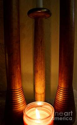 Photograph - Candle Illuminates Wooden Bobbins by Kerri Mortenson
