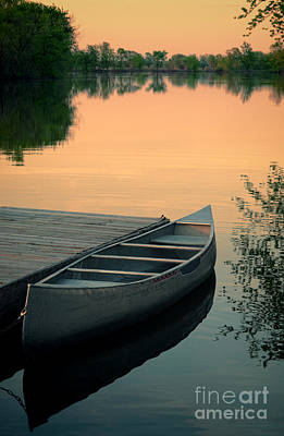 Canoe At A Dock At Sunset Art Print by Jill Battaglia