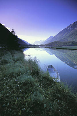 Canoe Sits At Lake Side Kenai Mtns Art Print by Jeff Schultz