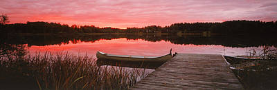 Canoe Photograph - Canoe Tied To Dock On A Small Lake by Panoramic Images