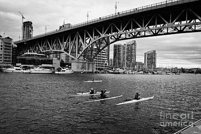 canoeists canoeing along false creek underneath the granville bridge Vancouver BC Canada Print by Joe Fox