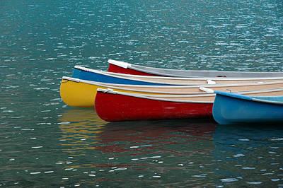 Photograph - Canoes At Moraine Lake Near Banff Alberta by Rob Huntley