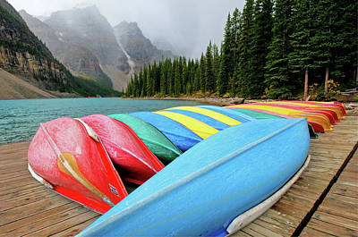 Green Color Photograph - Canoes Line Dock At Moraine Lake, Banff by Wildroze