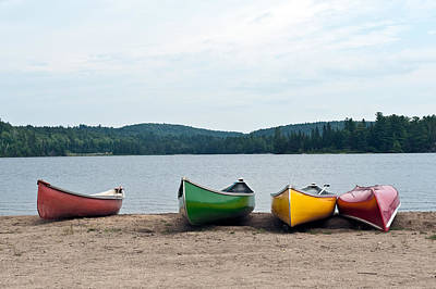 Canoes On The Lake Art Print by Marek Poplawski