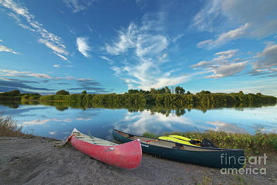Photograph - Canoes With Clouds Reflecting  by Yva Momatiuk John Eastcott