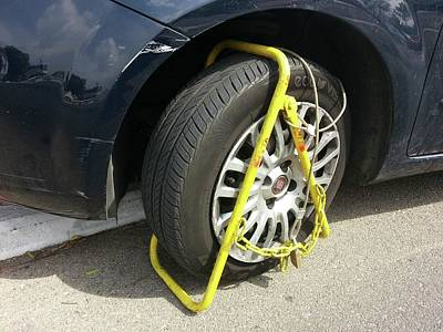Car Clamped For Illegal Parking Art Print