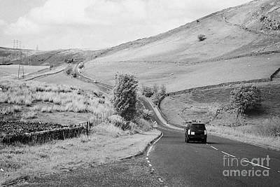 Carriageway Photograph - Car On A6 Road Through The Borrowdale Valley In Cumbria Uk by Joe Fox