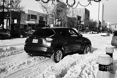 car stuck in deep snow on downtown city street Saskatoon Saskatchewan Canada Art Print
