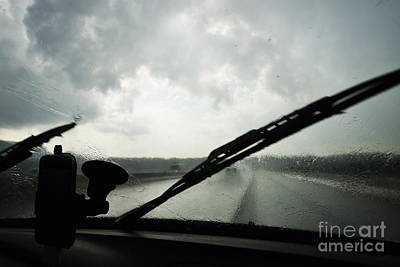 Car Windshield By Heavy Rains On Road Art Print