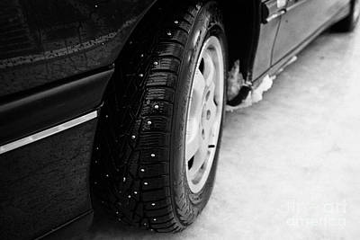 Ice Spikes Photograph - Car With Studded Winter Tyres On Ice Norway by Joe Fox