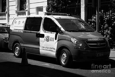 Police Van Photograph - carabineros de chile national police radio patrol riot van vehicle in downtown Santiago Chile by Joe Fox
