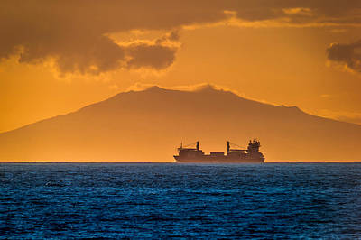 Solstice Photograph - Cargo Ship At Sunset by Panoramic Images