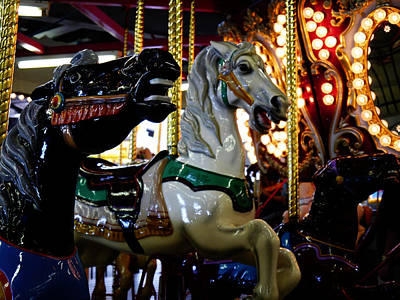 Photograph - Carousel Charge by Richard Reeve