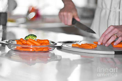 Photograph - Carrot Cutting In Kitchen by Gunter Nezhoda