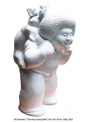 Andis Sculpture - Carrying The Bank by Adi Gunawan