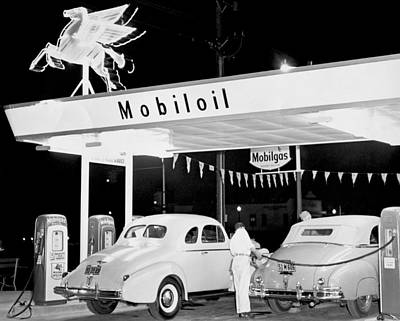 Cars At A Mobil Gas Station Art Print by Underwood Archives