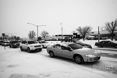 Gridlock Photograph - cars in traffic jam travelling along 8th street Saskatoon Saskatchewan Canada by Joe Fox