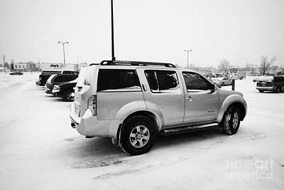 cars parked in store parking lot family reserved space in snowstorm blizzard Saskatoon Saskatchewan  Art Print by Joe Fox