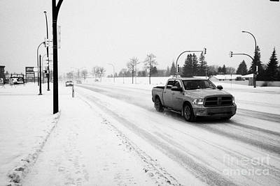 cars travelling along 8th street in blizzard conditions Saskatoon Saskatchewan Canada Art Print
